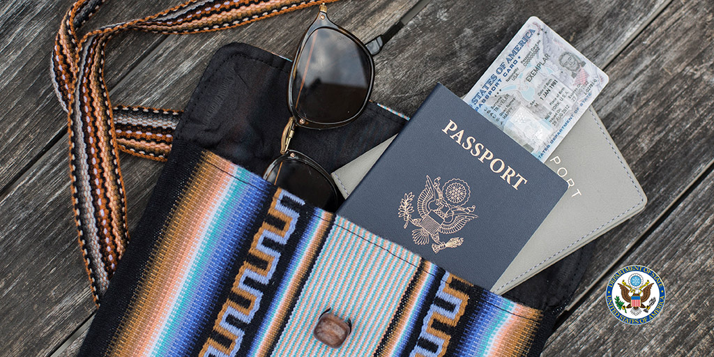 Travel bag with passport, passport card and glasses in it.